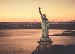 fly with Flynyon over New York City State of Liberty at the sunset